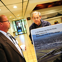 051514  Adron Gardner/Independent<br /> <br /> New Mexico Department of Transportation project design engineer Mark Fahey, left, looks on as local businessman Louis Bonaguidi examines a blueprint for  the South 2nd Street Bridge Replacement plan at City Hall in Gallup Thursday.