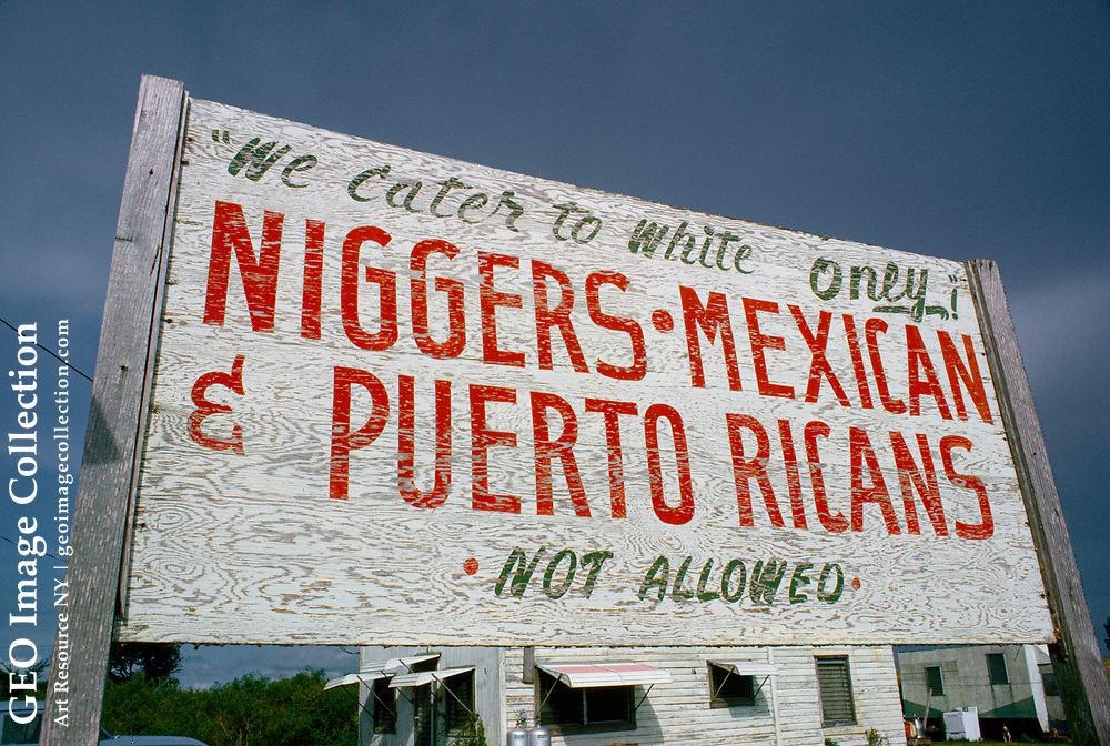 Hateful sign posting a whites only message.