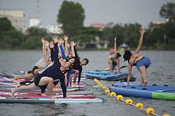 June 10, 2017 - Bangkok, Samut Prakan Province, Thailand - Participants in enjoys a paddleboard yoga session at Taco Lake Samut Prakan Province Thailand. June 10, 2017  (Credit Image: © Anusak Laowilas/NurPhoto via ZUMA Press)