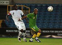 Photo: Tony Oudot.<br /> Ghana v Senegal. International Friendly. 21/08/2007.<br /> Hadji El Diouf of Senegal goes past Michael Essien of Ghana