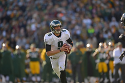 GREEN BAY, WI - NOVEMBER 10: Nick Foles #9 of the Philadelphia Eagles scrambles against the Green Bay Packers at Lambeau Field on November 10, 2013 in Green Bay, Wisconsin. (Photo by Drew Hallowell/Philadelphia Eagles/Getty Images) *** Local Caption ***  Nick Foles