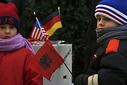 """Kosovo, Pristina (""""Mother Teresa"""" square)<br /> <br /> Two Kosovo Albanian kids, with them parent's buy Albanian and American flag's, they like to wave them before Kosovo will get Independent.<br /> <br /> photo by: VEDAT xhymshiti"""
