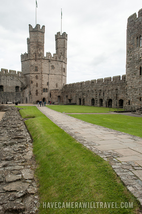 A walkway at Caernarfon Castle in northwest Wales. A castle originally stood on the site dating back to the late 11th century, but in the late 13th century King Edward I commissioned a new structure that stands to this day. It has distinctive towers and is one of the best preserved of the series of castles Edward I commissioned.