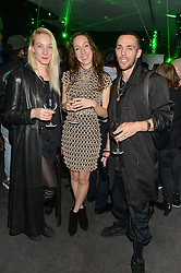 Left to right, JEN GILPIN, IRIS VAN HERPEN and MAXIME BALLESTEROS at a reception to celebrate Dom Perignon and Iris van Herpen's collaboration 'Metamorphosis' held at the Hus Gallery, 10 Hanover Street, London on 27th October 2014.