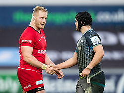 Vincent Koch of Saracens shakes hands with Dan Evans of Ospreys after the match<br /> <br /> Photographer Simon King/Replay Images<br /> <br /> European Rugby Champions Cup Round 5 - Ospreys v Saracens - Saturday 11th January 2020 - Liberty Stadium - Swansea<br /> <br /> World Copyright © Replay Images . All rights reserved. info@replayimages.co.uk - http://replayimages.co.uk