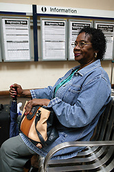 Woman for a train in the waiting room at the railway station,