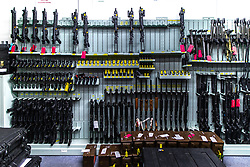 © Licensed to London News Pictures . 13/06/2019. Manchester , UK . Police issue firearms and tasers on one wall of the store . Inside Greater Manchester Police's weapons store at Claytonbrook in Openshaw where police issue firearms and recovered weapons are held . Photo credit : Joel Goodman/LNP