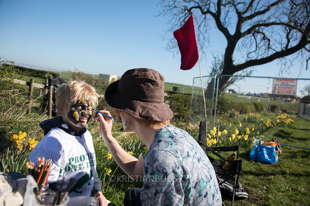 Newt face paint. Day of protest in Pont Valley, 5 May 2018 against the extraction of coal by the mining company Banks outside Dipton in Pont Valley, County Durham. Locals have fought the open cast coal mine for thirty years and three times the local council rejected planning permissions but central government has overruled that decision and the company Banks was granted the license and rights to extract coal in early 2018. Locals have teamed up with climate campaigners and together they try to prevent the mining from going ahead. The mining will have huge implications on the local environment and further coal extraction runs agains the Paris climate agreement. A rare species of crested newt live on the land planned for mining and protectors are trying to stop the mine to save the newt.