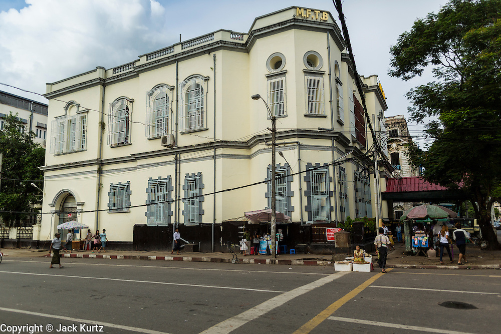07 JUNE 2014 - YANGON, MYANMAR: A renovated colonial era building in downtown Yangon. The building is now the Myanmar Foreign Trade Bank (MFTB). Yangon has the highest concentration of colonial style buildings still standing in Asia. Efforts are being made to preserve the buildings but many are in poor condition and not salvageable.    PHOTO BY JACK KURTZ