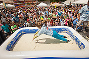 A competitor dives into a pool of instant grits during the grits roll competition at the World Grits Festival April 14, 2012 in St. George, SC. The festival celebrates the southern love for the sticky corn porridge