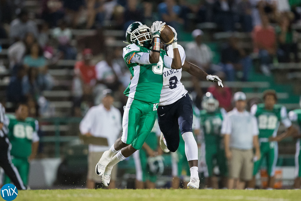 Equarius Baldwin (3) of the A.L. Brown Wonders intercepts a pass intended for Michael Roberts (8) of the Vance Cougars during first half action at A.L. Brown High School on September 30, 2016 in Kannapolis, North Carolina.  The Wonders defeated the Cougars 24-21.  (Brian Westerholt/Special to the Tribune)