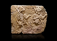 Hittite relief sculpted orthostat stone panel of Long Wall Limestone, Karkamıs, (Kargamıs), Carchemish (Karkemish), 900-700 B.C. . Anatolian Civilisations Museum, Ankara, Turkey.<br /> <br /> Two helmeted soldiers in short skirt carry shield on their backs and spear in their hands.<br /> <br /> On a black background. .<br />  <br /> If you prefer to buy from our ALAMY STOCK LIBRARY page at https://www.alamy.com/portfolio/paul-williams-funkystock/hittite-art-antiquities.html  - Type  Karkamıs in LOWER SEARCH WITHIN GALLERY box. Refine search by adding background colour, place, museum etc.<br /> <br /> Visit our HITTITE PHOTO COLLECTIONS for more photos to download or buy as wall art prints https://funkystock.photoshelter.com/gallery-collection/The-Hittites-Art-Artefacts-Antiquities-Historic-Sites-Pictures-Images-of/C0000NUBSMhSc3Oo
