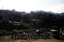 People line up to wait for the bus in a poor neighborhood in eastern Caracas. The Venezuelan government has long subsidized gasoline, making it one of the cheapest places in the world to buy gas.  Upper and middle class can buy new cars and not worry about gas mileage, while the lower class deals with a saturated public transportation system.