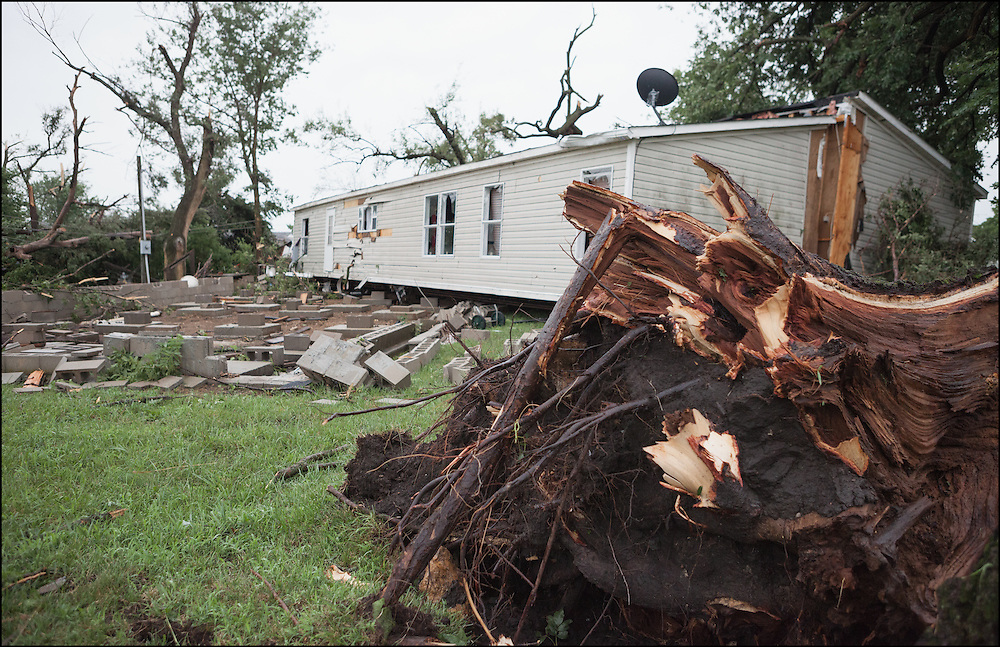 An EF-2 tornado ripped through Eureka, Kansas pushing this one off of its foundation and ripping a large tree out of the ground.