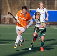 ROTTERDAM -  Floris Wortelboer (Bldaal) met Menno Boeren (Rotterdam)  tijdens de competitie hoofdklasse hockeywedstrijd mannen,  Rotterdam-Bloemendaal (1-2).  COPYRIGHT  KOEN SUYK