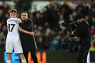 Carlos Carvalhal , the Swansea city manager hugs Sam Clucas of Swansea city at the end of the game. Premier league match, Swansea city v Liverpool at the Liberty Stadium in Swansea, South Wales on Monday 22nd January 2018. <br /> pic by  Andrew Orchard, Andrew Orchard sports photography.