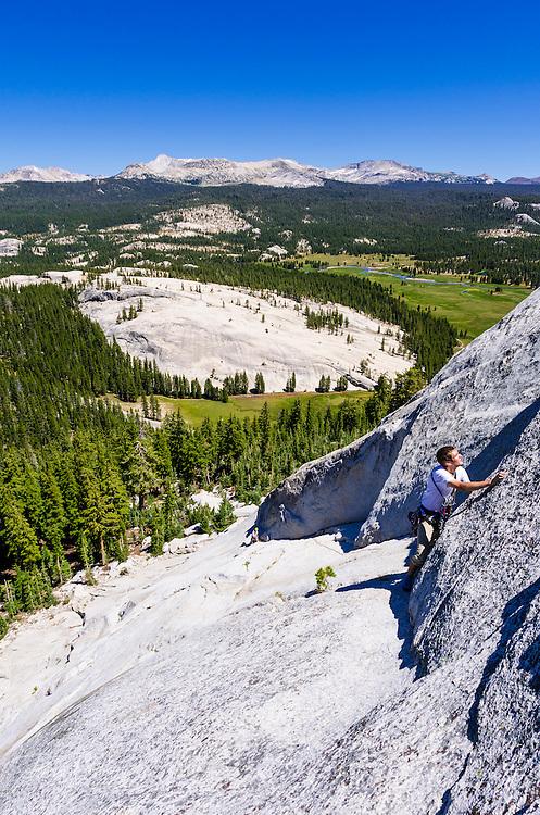 Rock climbers on Marmot Dome, Tuolumne Meadows, Yosemite National Park, California USA