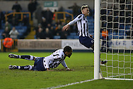 Shaun Cummings of Millwall (on ground) scores his sides 2nd goal. The Emirates FA Cup 3rd round match, Millwall v AFC Bournemouth at The Den in London on Saturday 7th January 2017.<br /> pic by John Patrick Fletcher, Andrew Orchard sports photography.