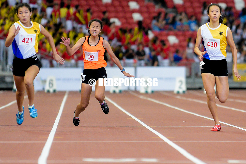 Bernice Liew (#421, on the left) and Elizabeth-Ann Tan (#430, on the right) of Nanyang Girls' High School go on to clinch first and second respectively in the B Division girls' 100m final. Raine Oh (#99, center) of Singapore Sports School falls. (Photo © Eileen Chew/Red Sports)