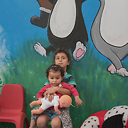 Syrian-Kurdish children, Ronash and Telnas, in a playroom at PIKPA, a refuge opened in January 2016 by the Leros Solidarity Network as a shelter for families and unaccompanied minors.