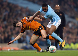 Wolverhampton Wanderers' Ruben Vinagre (left) and Manchester City's Raheem Sterling battle for the ball