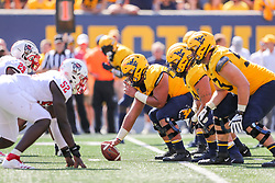 Sep 14, 2019; Morgantown, WV, USA; West Virginia Mountaineers offensive lineman Briason Mays (68) pauses before snapping the ball during the fourth quarter against the North Carolina State Wolfpack at Mountaineer Field at Milan Puskar Stadium. Mandatory Credit: Ben Queen-USA TODAY Sports