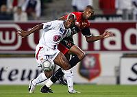 Fotball<br /> Frankrike 2004/05<br /> Rennes v Lyon<br /> 11. september 2004<br /> Foto: Digitalsport<br /> NORWAY ONLY<br /> SYLVAIN WILTORD (LYON) / ABDESLAM OUADDOU (REN)