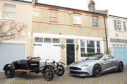 © Licensed to London News Pictures. 15/01/2013.The 100 years anniversary of Aston Martin.Plaque unveiling to mark 100th Anniversary of Aston Martin who started the company on this day (15thJanuary) in 1913 at this address(16 Henniker Mews, London, SW3 6BL).R/L    ultimate GT - the Vanquish - alongside the oldest Aston Martin in existence, A3.Photo credit : Grant Falvey/LNP