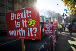 © Licensed to London News Pictures. 14/02/2019. London, UK. An anti Brexit sign outside the Houses of Parliament in Westminster, on the day that MPs are due to take part in further debates and votes on Brexit. A series of amendments are being tabled to try to change the direction of Brexit, but a vote on a deal will not be held today as was originally planned. Photo credit: Ben Cawthra/LNP