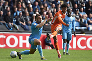 Shrewsbury Town midfielder Josh Laurent (28) takes a shot at goal during the EFL Sky Bet League 1 match between Coventry City and Shrewsbury Town at the Ricoh Arena, Coventry, England on 28 April 2019.
