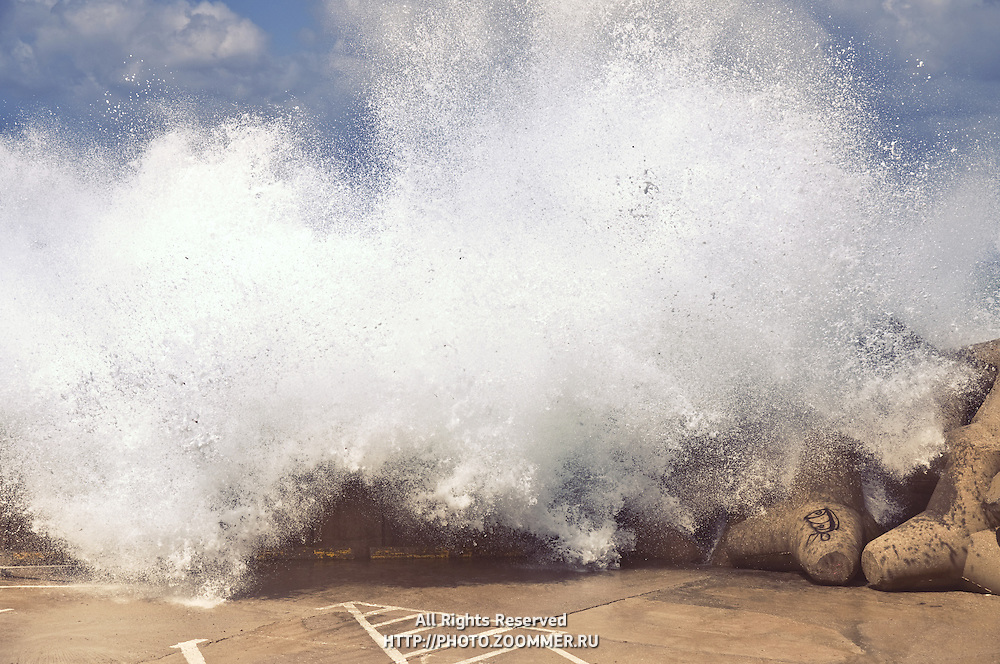 Big waves crashing over the breakwater in Rethymno, Crete island, Greece