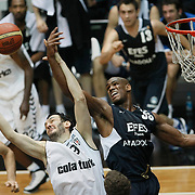 Besiktas's Cevher OZER (L), Bekir YARANGUME (C)  and Efes Pilsen's Ersin DAGLI (R) during their Turkish Basketball league derby match Besiktas between Efes Pilsen at the BJK Akatlar Arena in Istanbul Turkey on Saturday 30 April 2011. Photo by TURKPIX