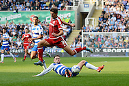 Reading midfielder Oliver Norwood tackles Middlesbrough defender George Friend during the Sky Bet Championship match between Reading and Middlesbrough at the Madejski Stadium, Reading, England on 3 October 2015. Photo by Alan Franklin.