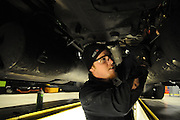 Amid the grease and grime of the maintenance pits, Repair Technician John Chesnut replaces an air tank line at the TA Travel Centers of America service area in Morris, Illinois.