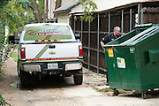 Police stand next to a hazmat truck behind the apartment where a second Ebola patient has been reported in Dallas, Texas on October 12, 2014. (Cooper Neill for The New York Times)