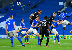 West Ham United's Craig Dawson (centre) attempts to head the ball during the Premier League match at the American Express Community Stadium, Brighton. Picture date: Saturday May 15, 2021.