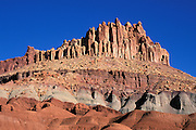 Morning light on the Castle under blue sky, Waterpocket Fold near Fruita, Capitol Reef National Park, Utah