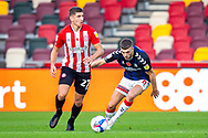 Brentford midfielder Vitaly Janelt (27) loses Middlesbrough midfielder Lewis Wing (8) during the EFL Sky Bet Championship match between Brentford and Middlesbrough at Brentford Community Stadium, Brentford, England on 7 November 2020.