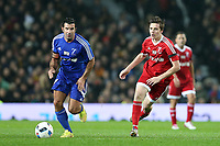 Luis Figo and Brooklyn Beckham during the Match for Children in aid of Unicef between Great Britain XI v Rest of World XI played at Old Trafford, Manchester on 14th November 2015. Photo Paul Greenwood / Backpage Images / DPPI