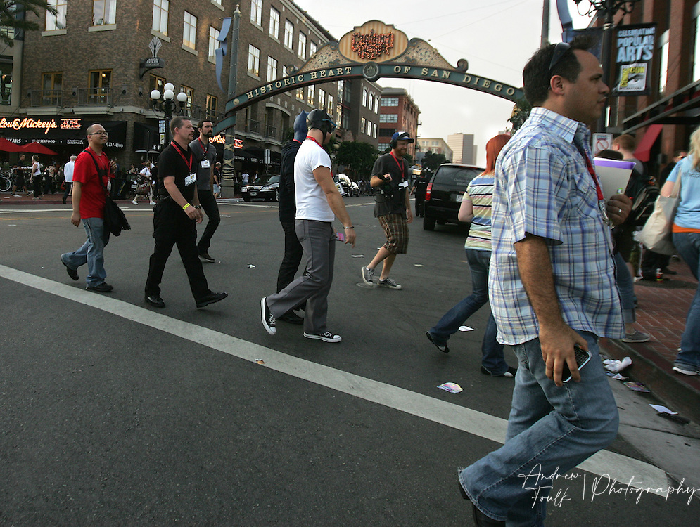 """Andrew Foulk/ Zuma Press.July 24, 2009, San Diego, California, USA. Comic Con. Comic Con attendees  cross into the """" Gaslamp Quarter"""" of San Diego after leaving day two of the 40th annual San Diego International Comic Con."""