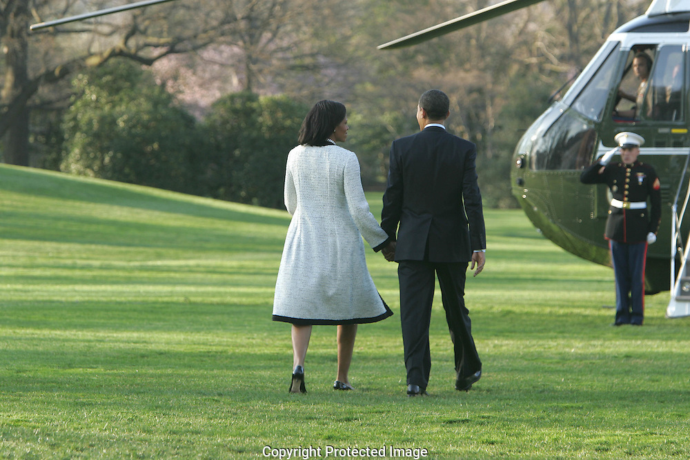 President Barack Obama and First Lady Michelle Obama walk to Marine One on their way to Andrews Air Force Base and Air Force One which will take them to London for the Economic Summit. Photograph by Dennis Brack