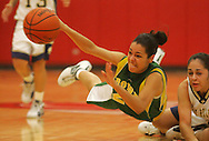 Rowe's Alejandra Perez dives for a loose ball, deflecting it away from Laredo's Amanda Mancha during Monday night's game in Roma.