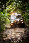 Four wheel drive, driving through forest track, Meru Betiri National Park, East Java, Indonesia, Southeast Asia