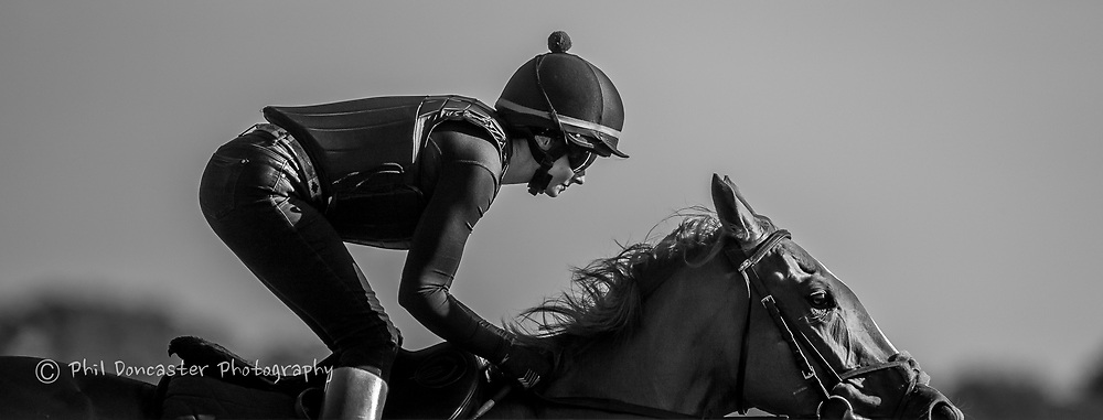 Rails reflect in work riders goggles at Newmarket Gallops