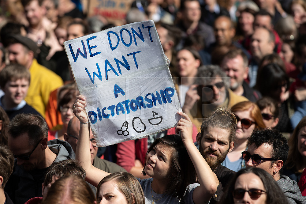 """© Licensed to London News Pictures. 31/08/2019. Manchester, UK. A placard reading """" We don't want a dictatorship """" .Thousands attend a pro EU demo in Albert Square Manchester City Centre , with objections raised to the Prime Minister Boris Johnson's intention to prorogue Parliament in the run up to Britain's planned Brexit deadline . Photo credit: Joel Goodman/LNP"""