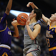 HARTFORD, CONNECTICUT- JANUARY 4: Kia Nurse #11 of the Connecticut Huskies drives to the basket defended by Fanni Csutoras #13 of the East Carolina Lady Pirates and Raven Johnson #11 of the East Carolina Lady Pirates during the UConn Huskies Vs East Carolina Pirates, NCAA Women's Basketball game on January 4th, 2017 at the XL Center, Hartford, Connecticut. (Photo by Tim Clayton/Corbis via Getty Images)
