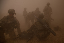 US and Afghan soldiers are shrouded in the dust kicked up by a landing US medical evacuation helicopter as they wait to load the lifeless body of an Afghan soldier killed when a remote-controlled IED was detonated as a group of US and Afghan soldiers were entering the Kandahari village of Zenadan in the province's Zhari District on Sept. 17, 2010. The IED - which appears to have been detonated in a deliberate attempt to kill an US and Afghan lieutenant colonel who were in the column - also left one US soldier critically wounded.