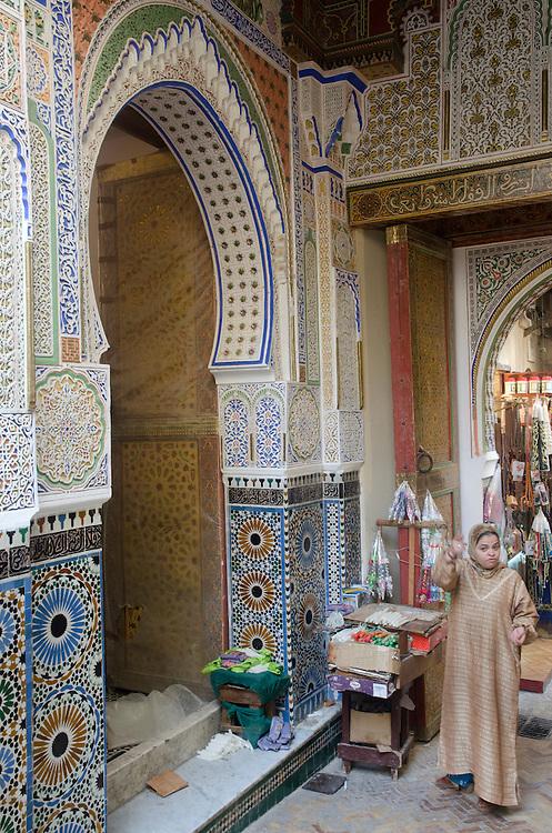 Woman outside her shop, Fes el Bali Morocco