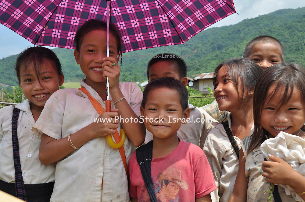 a group of smiling children in Laos