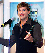 "Latin singer Ricky Martin talks to the media after winning the ""Spirit of Hope Award"" at the 2002 Latin Billboard Awards show in Miami Beach, Florida May 9, 2002. Martin recieved the award for his work with a medical foundation in Puerto Rico. PHOTO BY: COLIN BRALEY"